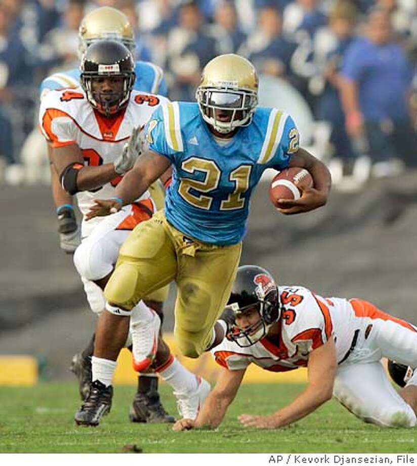 UCLA tailback Maurice Drew (21) breaks a tackle thrown by Oregon State punter Sam Paulescu (34) as he returns a punt for 59-yards to set up a touchdown during the second quarter Saturday, Oct. 22, 2005, at the Rose Bowl, in Pasadena, Calif. (AP Photo/Kevork Djansezian) Ran on: 10-23-2005  Matt Leinart completes one of his 20 passes en route to 201 yards and four touchdowns. Ran on: 10-23-2005  Matt Leinart completes one of his 20 passes en route to 201 yards and four touchdowns. Ran on: 10-23-2005  Matt Leinart completes one of his 20 passes en route to 201 yards and four touchdowns. Photo: KEVORK DJANSEZIAN