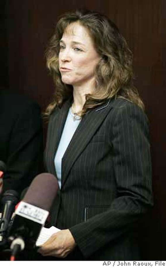 **FILE** Lisa Nowak makes a brief statement to the media outside the courtroom after a hearing at the Orange County courthouse in Orlando, Fla. in this Friday, Aug. 24, 2007 file photo. Former astronaut Lisa Nowak is pursuing an insanity defense on charges that she assaulted and tried to kidnap a romantic rival, according to a document released Tuesday, Aug. 28, 2007. (AP Photo/John Raoux, FILE) AN AUG. 24, 2007 FILE PHOTO Photo: John Raoux