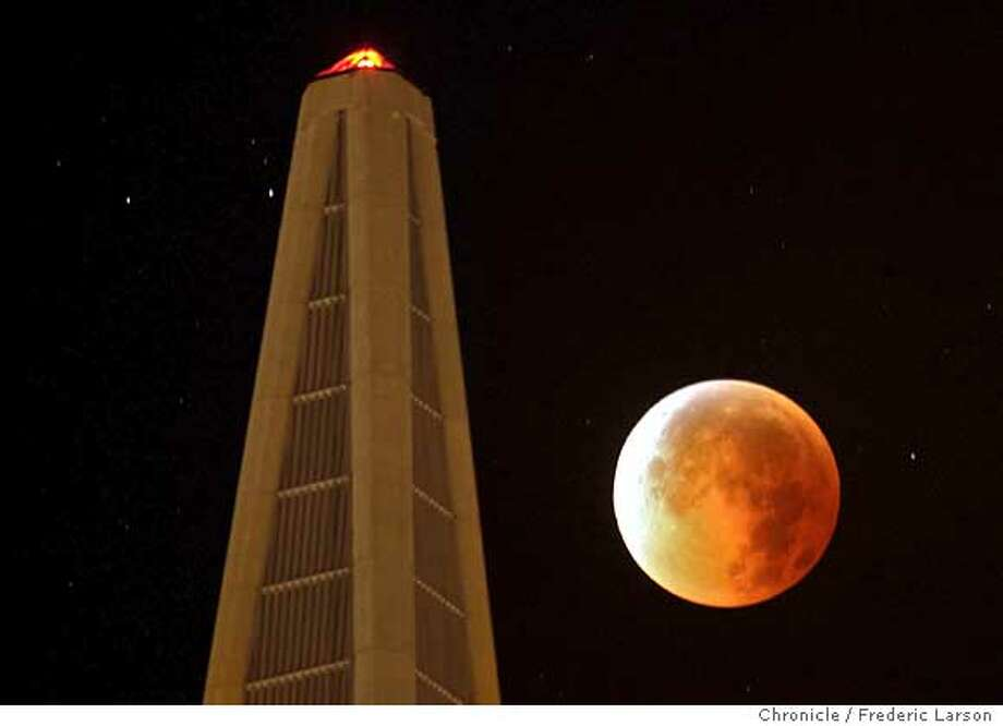 The moon turned a yellowish brown to a blood red during Tuesday night's total lunar eclipse as it passed by the TransAmerican Pyramid in San Francisco. The moon's surface darken as the earth's shadow creeped across it to create a partial eclipse from just before 1:51am (PST) with the total eclipse visible one hour later. 8/28/07  {Photographed by } Photo: Frederic Larson