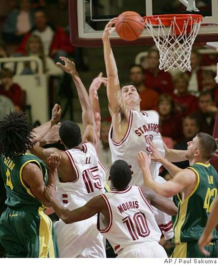 Stanford forward Matt Haryasz gets a rebound in front of players, from left to right, Oregon guard Bryce Taylor (4), Stanford forward Lawrence Hill (15), Stanford guard Tim Morris (10), and Oregon forward Adam Zahn (42) during the second half of a college basketball game Saturday, Jan. 7, 2006, in Stanford, Calif. Stanford won 64-62. (AP Photo/Paul Sakuma) Photo: PAUL SAKUMA