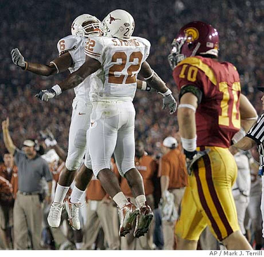 University of Texas' Selvin Young (22) celebrates his second quarter touchdown with teammate Quan Cosby (6) as Southern California's Brian Cushing (10), who missed the scoring tackle, walks away in the Rose Bowl, the national championship college football game, Wednesday, Jan. 4, 2006, in Pasadena, Calif. (AP Photo/Mark J. Terrill) SPMEF OUT Photo: MARK J TERRILL