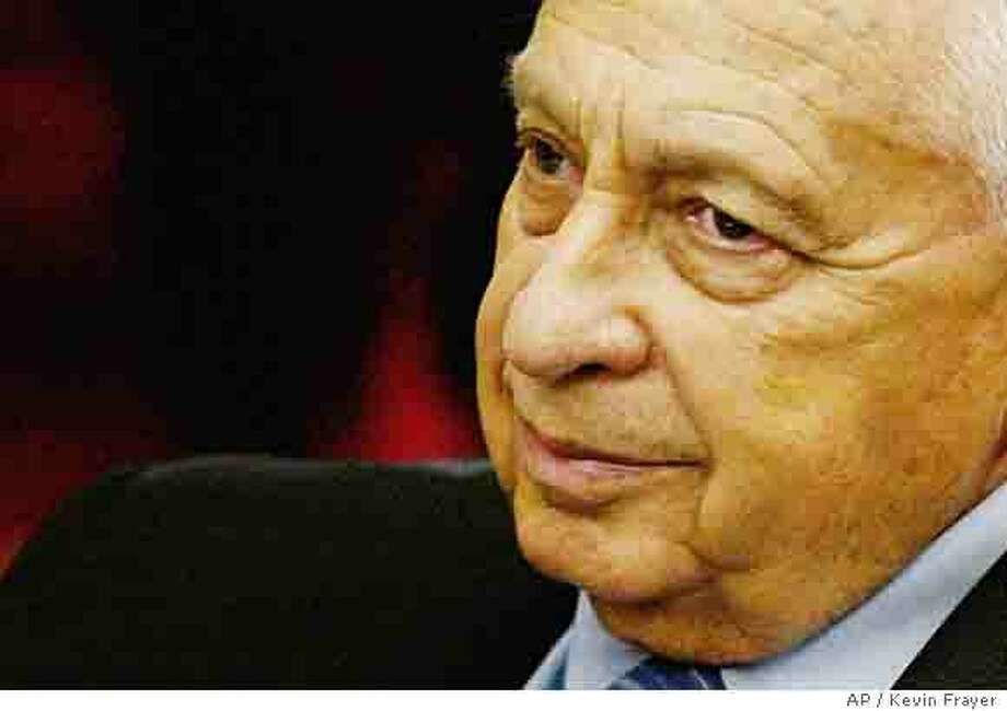 """** FILE ** Israeli Prime Minister Ariel Sharon is seen during a meeting at the Knesset, Israel's Parliament in Jerusalem, in this June 20, 2005 file photo. Sharon suffered a cerebral hemorrhage Wednesday Jan. 4, 2006 and was receiving breathing assistance while under general anesthetic, a hospital official said. Power was transferred to his deputy. Sharon, 77, suffered a """"significant"""" stroke and was brought to Jerusalem's Hadassah Hospital from his ranch in the Negev desert, an official said. (AP Photo/Kevin Frayer/File) JUNE 20, 2005 FILE PHOTO Photo: KEVIN FRAYER"""