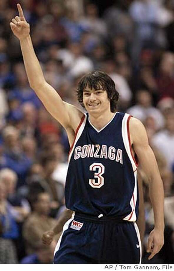 Gonzaga's Adam Morrison celebrates after beating Saint Louis, 60-57, Thursday, Dec. 22, 2005 in their men's college basketball game at Savvis Center in St. Louis. Morrison scored 14 of his 18 points in the second half to lead all scorers.(AP Photo/Tom Gannam) Photo: TOM GANNAM