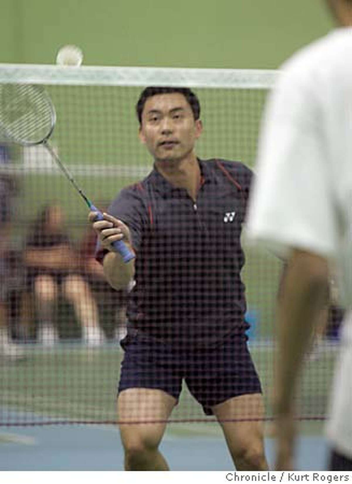 Mike Yang the owner of the club at one time was ranked #2 in the World. Golden Gate Badminton Club in Menlo Park had a waiting list to get on a court, Badminton, the backyard sport of yore, is enjoying a huge surge in popularity in the U.S, driven by waves immigration from Asia. Golden Gate Badminton Club, owner Mike Yang. Kurt Rogers MENLO PARK SFC The Chronicle BADMINTON_00516_kr.JPG MANDATORY CREDIT FOR PHOTOG AND SF CHRONICLE/ -MAGS OUT