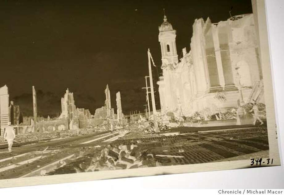 quakephotos_013_mac.jpg One of the 40 negatives sits on a light table, a scene of a SF street as it was titled. California Historical Society has acquired a set of negatives of never before seen pictures of the 1906 SF earthquake taken by jack London or his wife, Charmain. London covered the quake for Collier's magazine but also made a northern trip to Marin, Sonoma, Mendocino counties to see quake damage. negatives of London pix been in huntington museum for nearly 100 years. California Historical Society photo guy Phillip Adam (who usta work for the chronicle) is developing them. Event in San Francisco, Ca on 1/5/06. Photo by: Michael Macor / San Francisco Chronicle Mandatory Credit for Photographer and San Francisco Chronicle/ - Magazine Out Photo: Michael Macor