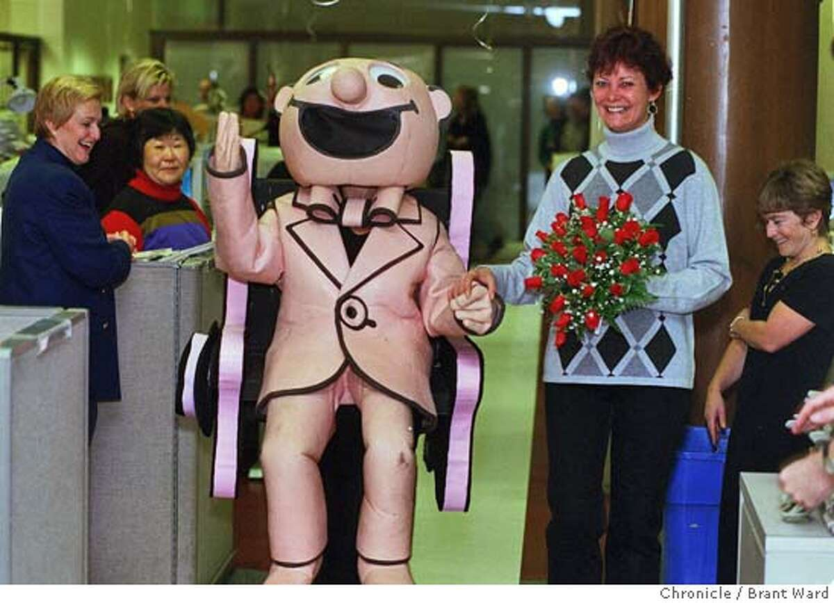 WEDDING1/13NOV98/MN/BW--Kath Hughes being marched down the aisle by Ellen Miller in The Little Man costume in the Chronicle newsroom attracted the attention of employees. By Brant Ward/Chronicle