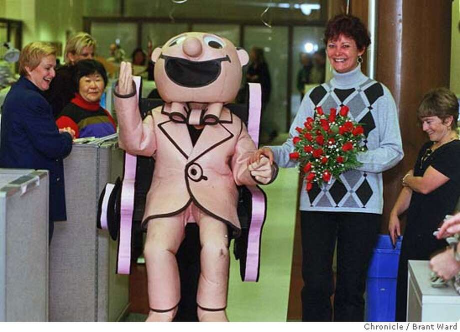 WEDDING1/13NOV98/MN/BW--Kath Hughes being marched down the aisle by Ellen Miller in The Little Man costume in the Chronicle newsroom attracted the attention of employees. By Brant Ward/Chronicle Photo: BRANT WARD