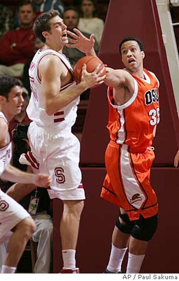 Stanford center Peter Prowitt, left, gets the rebound in front of Oregon State center Kyle Jeffers, right, in the first half of Pac-10 college basketball actionThursday, Jan. 5, 2006, in Stanford, Calif. (AP Photo/Paul Sakuma) Photo: PAUL SAKUMA