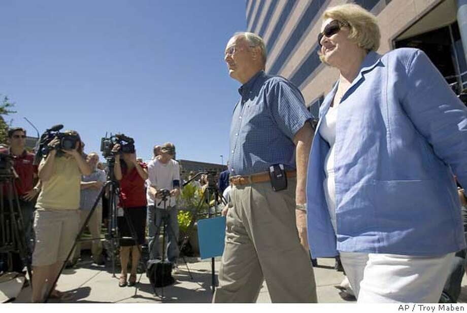 Idaho Sen. Larry Craig and his wife, Suzanne, make their way to a podium set up outside the Wells Fargo Building to read a statement to the media Tuesday, Aug. 28, 2007, in downtown Boise, Idaho. (AP Photo/Troy Maben) Photo: Troy Maben