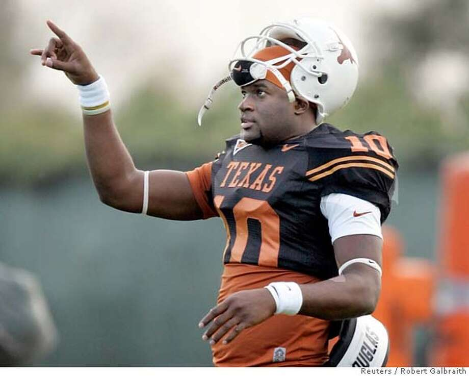 University of Texas quarterback Vince Young gestures during workouts in Carson, California, December 29, 2005. The Longhorns meet the University of Southern California for the national championship in the Rose Bowl game to be played on January 4. REUTERS/Robert Galbraith 0 Photo: ROBERT GALBRAITH