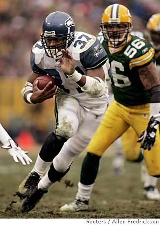 Seattle Seahawks running back Shaun Alexander (37) gains twelve yards with Green Bay Packers linebacker Nick Barnett (56) in pursuit during the second quarter at Lambeau Field in Green Bay, Wisconsin January 1, 2006. Playing the first half, Alexander led all rushers with 73 yards, and also totaled the most yardage in the NFL with 1,880 yards this season. REUTERS/Allen Fredrickson Photo: ALLEN FREDRICKSON