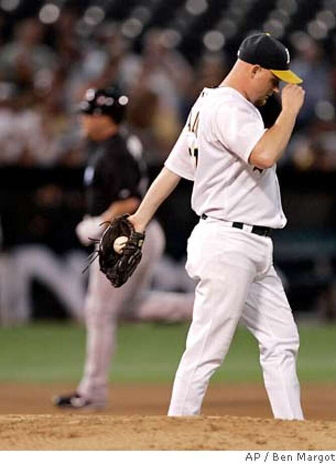 Toronto Blue Jays' Matt Stairs, left, rounds the bases after hitting a home run off Oakland Athletics' Chad Gaudin, right, in the fourth inning of a baseball game Tuesday, Aug. 28, 2007, in Oakland, Calif. (AP Photo/Ben Margot) Photo: Ben Margot