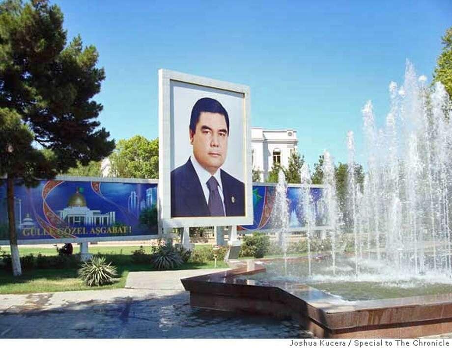 A poster of Turkmenistan President Gurbanguly Berdimuhammedov in central Ashgabat. Joshua Kucera / Special to The Chronicle MANDATORY CREDIT FOR PHOTOG AND SAN FRANCISCO CHRONICLE/NO SALES-MAGS OUT Photo: Joshua Kucera