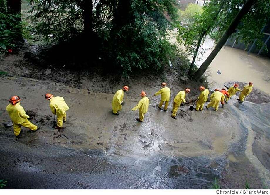 flood007_ward.jpg  Just off Neeley Road in Guerneville, a California state Correctional work crew from Lake County worked to clear mud from the street...crews could be found around the Russian River area Tuesday.  The flood that hit the Russian River just before New Years eve is still in evidence in Guerneville and the outlying areas. The river is now officially below flood stage and the cleanup is well underway.  Brant Ward1/3/06 Photo: Brant Ward