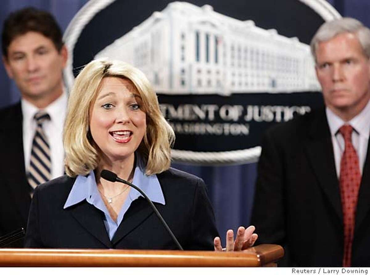 Assistant Attorney General Alice Fisher (C) is joined by FBI Assistant Director Chris Swecker (L) and IRS Commissioner Mark Everson (R) as she announces the guilty plea by lobbyist Jack Abramoff to three counts of conspiracy, aiding and abetting honest services mail fraud, and tax evasion, during a news conference at the Department of Justice in Washington January 3, 2006. Abramoff entered his plea earlier today in U.S. District Court in the District of Columbia and is facing up to 30 years in prison. REUTERS/Larry Downing 0