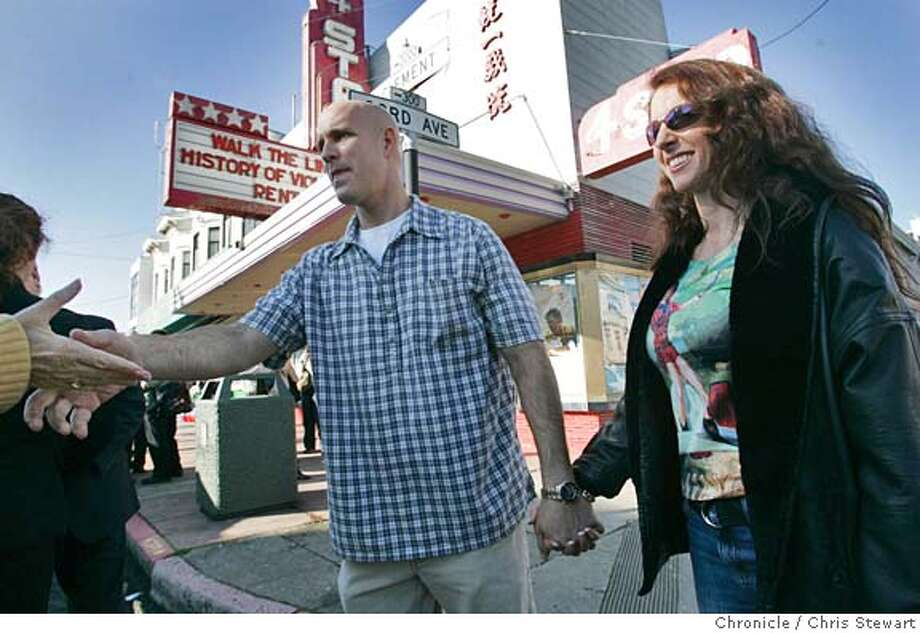 """video050185.jpg Event on 1/4/06 in San Francisco.  SFPD Officer Andrew Cohen (L) and his fiance� Wendy Hurley greet admirers outside the Four Star Theater following the premiere of Cohen�s video epic """"Inside the SFPD - the Bayview."""" The Four Star Theater is located at 2200 Clement Street in the Richmond District.  Chris Stewart / The Chronicle MANDATORY CREDIT FOR PHOTOG AND SF CHRONICLE/ -MAGS OUT Photo: Chris Stewart"""