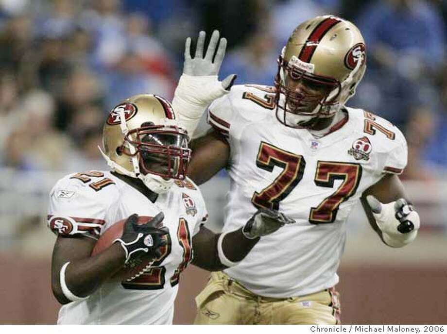 San Francisco 49ers Kwame Harris #77 pats San Francisco 49ers Frank Gore #21's head after his 1st quarter TD run.  San Francisco 49ers vs the Detroit Lions at Ford Field in Detroit Michigan. 49ers won 19-13.  Photo by Michael Maloney / San Francisco Chronicle on 11/12/06 in Detroit,MI ***  Ran on: 11-13-2006  Frank Gore (21) put the 49ers in a position to win against Detroit before leaving with a concussion.  Ran on: 11-13-2006 MANDATORY CREDIT FOR PHOTOG AND SF CHRONICLE/NO SALES-MAGS OUT Photo: Michael Maloney