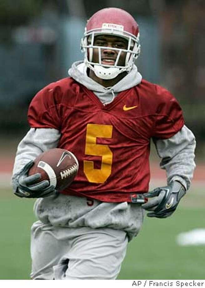 Southern California tailback Reggie Bush runs with the ball during a work-out in Los Angeles, Sunday, Jan. 1, 2006. The Trojans face the University of Texas in the national championship game at the Rose Bowl on Wednesday, Jan. 4.(AP Photo/Francis Specker) Photo: FRANCIS SPECKER
