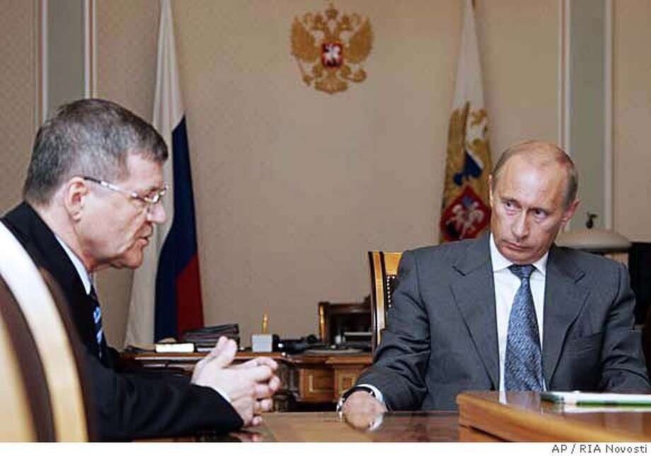 Prosecutor General Yuri Chaika , left, speaks to President Vladimir Putin in Moscow's Kremlin Monday, Aug. 27, 2007. Ten people have been arrested in the killing of investigative journalist Anna Politkovskaya and will be charged soon, Russian news agencies quoted the chief prosecutor as saying Monday. (AP Photo/ RIA Novosti, Mikhail Klimentyev, Presidential Press Service ) Photo: MIKHAIL KLIMENTYEV