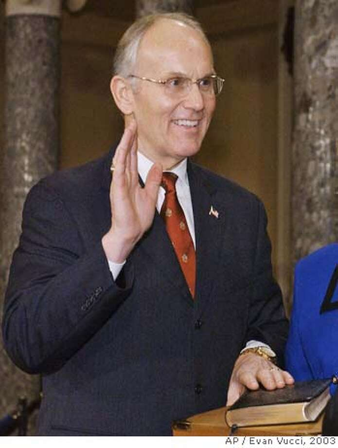 ** FILE **Sen. Larry Craig, R-Idaho, takes the oath of office during a mock swearing in ceremony in the Old Senate Chamber on Capitol Hill in Washington, in this Tuesday, Jan. 7, 2003, file photo. Craig of Idaho pleaded guilty in August 2007, to misdemeanor disorderly conduct after being arrested at the Minneapolis airport. Roll Call, a Capitol Hill newspaper, which first reported the case, said on its Web site Monday, Aug. 27, 2007, that Craig was arrested June 11 by a plainclothes officer investigating complaints of lewd conduct in a men's restroom at the airport. (AP Photos/Evan Vucci) JAN. 7, 2003, FILE PHOTO Photo: Evan Vucci