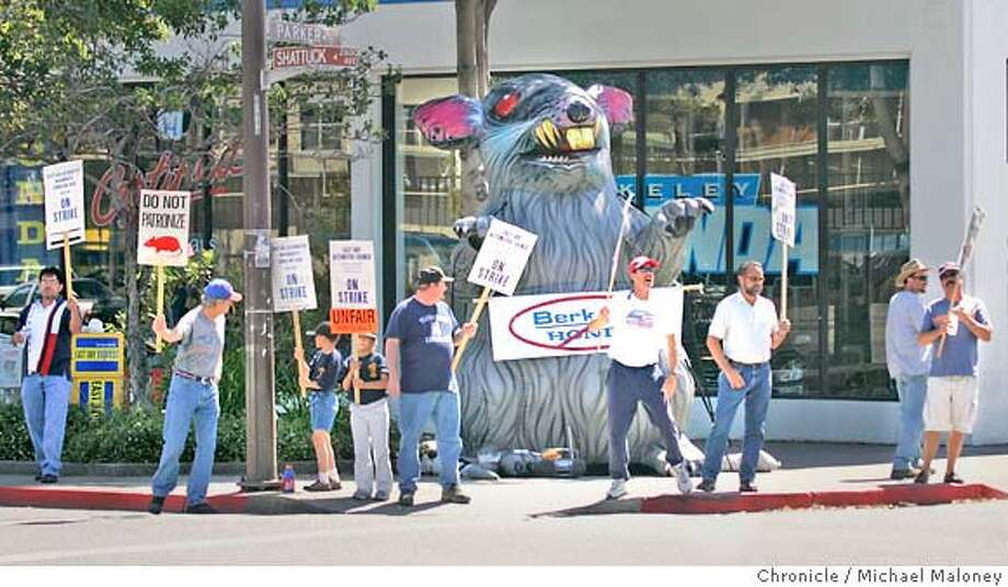 "HONDA_114_MJM.jpg  Former employees of Berkeley's Doten Honda are picketing outside the longtime high-volumn dealership after it's new owner laid off union service workers and set up a non-union shop on Shattuck Avenue in liberal Berkeley. Workers also set up a giant inflated rat on the street corner and are asking customers not to take their business there. The new owner is Stephen Bienke, son of a Danville developer who painted ""Strike Sale"" in the showroom window.  Photo by Michael Maloney / San Francisco Chronicle Ran on: 07-08-2005  Mechanics and other workers picket Berkeley Honda on Shattuck Avenue because new owners didn't hire several union members. Ran on: 07-08-2005  Picketers' giant rat Ran on: 07-08-2005  Mechanics and other workers picket Berkeley Honda on Shattuck Avenue because new owners didn't hire several union members. Ran on: 07-08-2005  Picketers' giant rat MANDATORY CREDIT FOR PHOTOG AND SF CHRONICLE/ -MAGS OUT Photo: Michael Maloney"