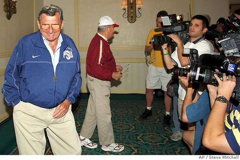 Penn State football coach Joe Paterno, left, smiles after greeting FSU coach Bobby Bowden during a press conferences at the Marriott Hotel in Fort Lauderdale, Fla., Thursday, Dec. 29, 2005. Florida State faces Penn State in Tuesday's Orange Bowl game in Miami. (AP Photo/Steve Mitchell) Photo: STEVE MITCHELL