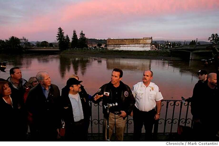NAPAFLOOD03_0201 1/2/06  California Governor Arnold Schwarzenegger(please correct spelling) visits Napa and is pictured here near the 3rd St. Bridge. Clean-up effort in downtown Napa on and around Pearl St. in Napa after floods. Event on 1/2/06 in Napa, CA. Photo: Mark Costantini /San Francisco Chronicle. Photo: MARK COSTANTINI