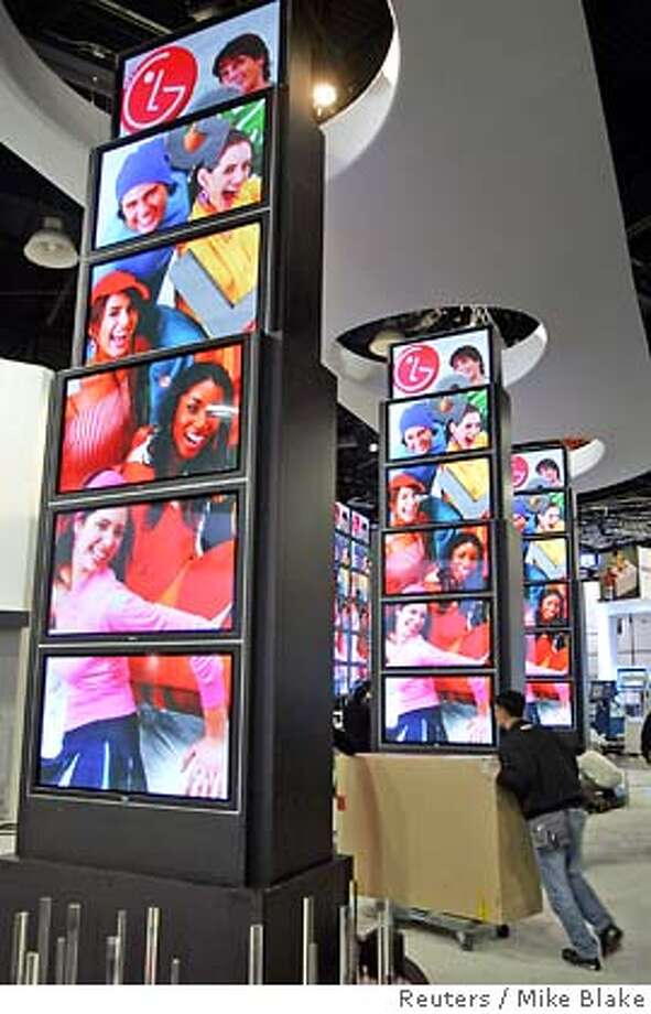 Flat screen televisions are vertically stacked for display in the LG Electronics booth at the 2005 International Consumer Electronics Show (CES) in Las Vegas January 5, 2005. The worlds hottest and newest technology from more than 2,400 global companies is debuting at the 2005 International Consumer Electronics Show from January 6-9, 2005. REUTERS/Mike Blake 0 Photo: MIKE BLAKE