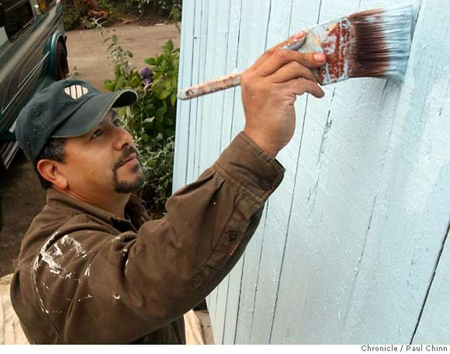 Contractor Ramon Neyra paints a fence at a job site in El Cerrito, Calif. on Friday, August 24, 2007. Now a U.S. citizen, Neyra worked for years as an illegal immigrant. PAUL CHINN/The Chronicle  **Ramon Neyra MANDATORY CREDIT FOR PHOTOGRAPHER AND S.F. CHRONICLE/NO SALES - MAGS OUT Photo: PAUL CHINN