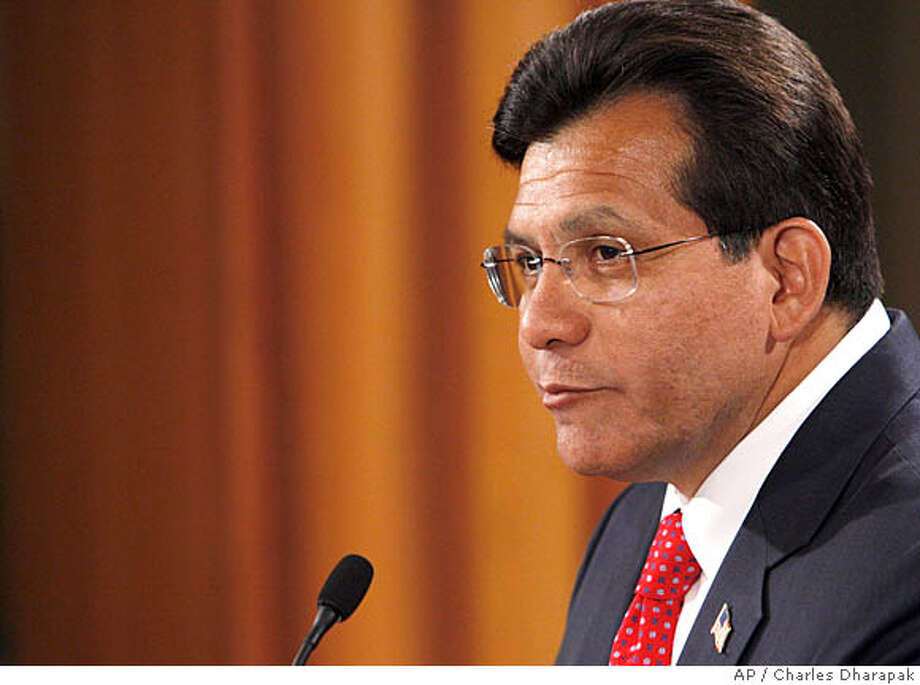 U.S. Attorney General Alberto Gonzales announces his resignation at the Justice Department in Washington, Monday, Aug. 27, 2007. Gonzales resigned, ending a months-long standoff with critics, who questioned his honesty and competence at the helm of the Justice Department. (AP Photo/Charles Dharapak) Photo: Charles Dharapak