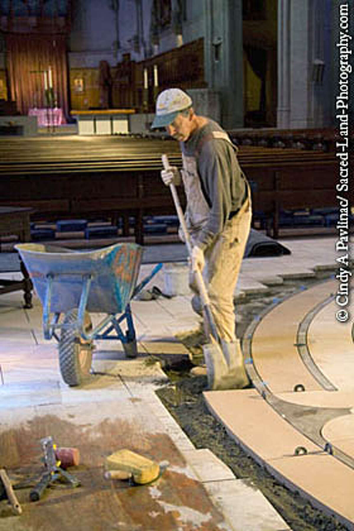 A worker lays stone for the labyrinth in the nave at Grace Cathedral in San Francisco. Photo by Cindy A. Pavlinac, courtesy of www.sacred-land-photography.com