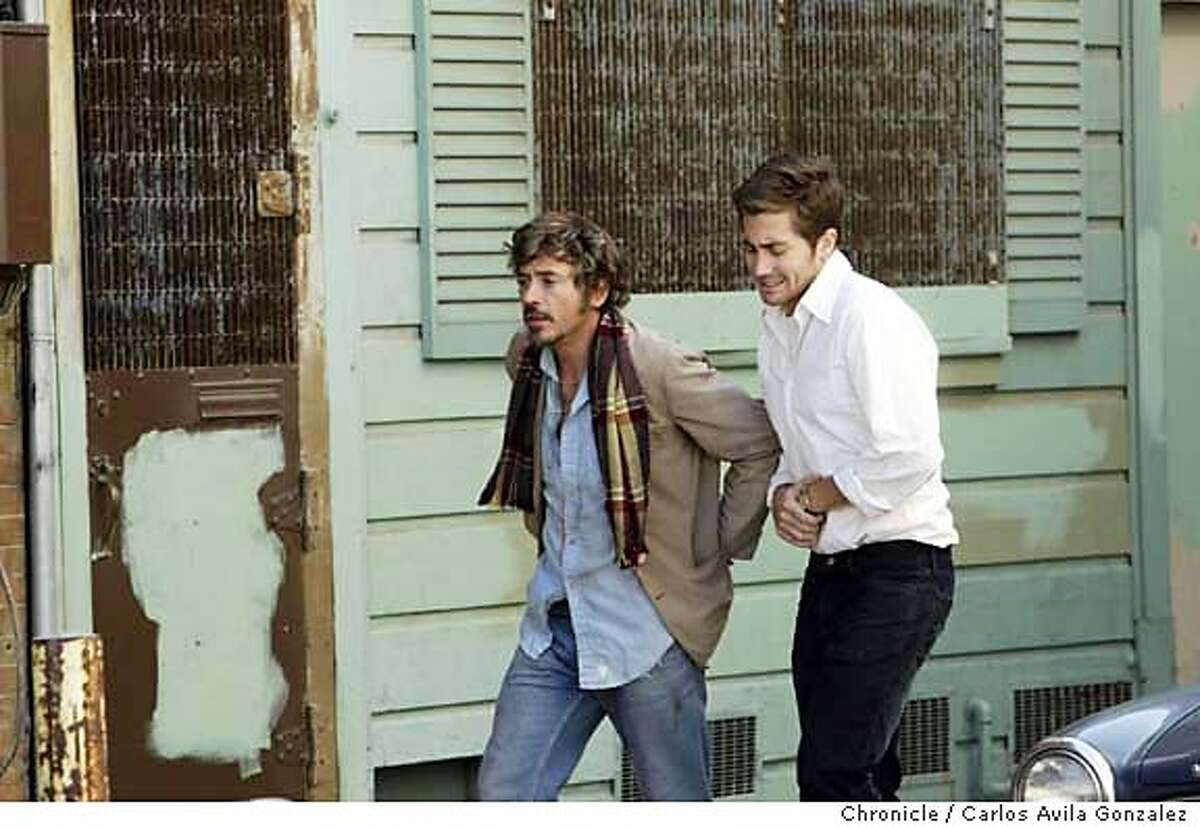 """Actors Robert Downey, Jr., left, and Jake Gyllenhaal, right, on the set of """"Zodiac."""" A movie crew will shoot a portion of """"Chronicles,"""" the Zodiac Killer film, in our mailroom beginning at noon. They'll shoot inside the room, on Minna St. and in a bar called Morti's (a fake set) in a Minna building we own. Warner Bros. has rented the spaces, so they're theirs to use. Photo by Carlos Avila Gonzalez / The San Francisco Chronicle Photo taken on 9/25/05, in San Francisco,CA."""