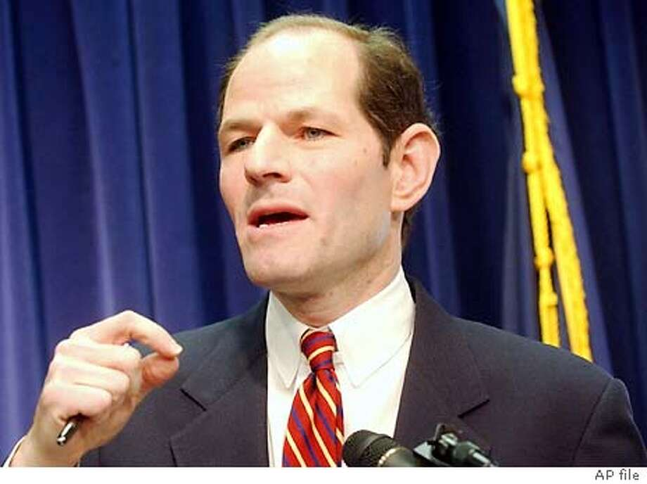 New York State Attorney General Eliot Spitzer gestures while speaking during a news conference Thursday, Dec. 18, 2003 in New York. Microsoft Corp. and New York's attorney general filed lawsuits Thursday against what they called a spam ring responsible for sending billions of illegal e-mail messages. (AP Photo/Frank Franklin II) Photo: FRANK FRANKLIN II