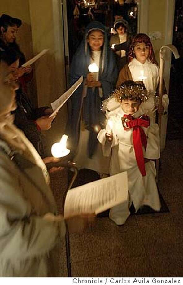 Front to Back, Jose Buendia, 6, Andy Gutierrez, and Arai Buendia 12, of Berkeley, Ca., dressed as the Angel, Joseph, and Mary, for the Posada that followed the evening Christmas Mass on December 24, 2003. It is a tradition in Mexico to recreate search for lodging that finally led them to the manger and Jesus's birth on Christmas Eve. Event on 12/24/03 in Berkeley, Ca. Photo By CARLOS AVILA GONZALEZ / The San Francisco Chronicle Photo: CARLOS AVILA GONZALEZ