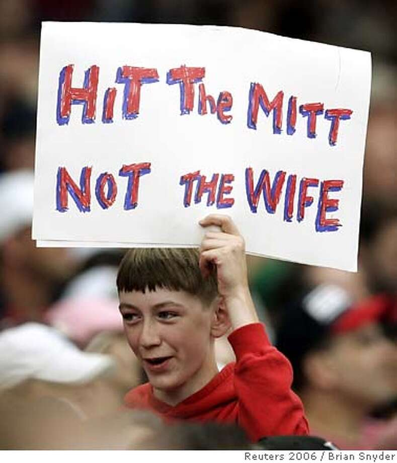 "A young fan carries a sign reading ""Hit the Mitt, Not the Wife"" while the Philadelphia Phillies' Brett Myers pitches to the Boston Red Sox in the second inning of their MLB baseball interleague game at Fenway Park in Boston, Massachusetts June 24, 2006. Myers was arrested June 23, 2006 and charged with assaulting his wife in downtown Boston. REUTERS/Brian Snyder (UNITED STATES)  Ran on: 07-02-2006  Young fan carries sign reading &quo;Hit the Mitt, Not the Wife&quo; while Brett Myers pitches. 0 Photo: BRIAN SNYDER"