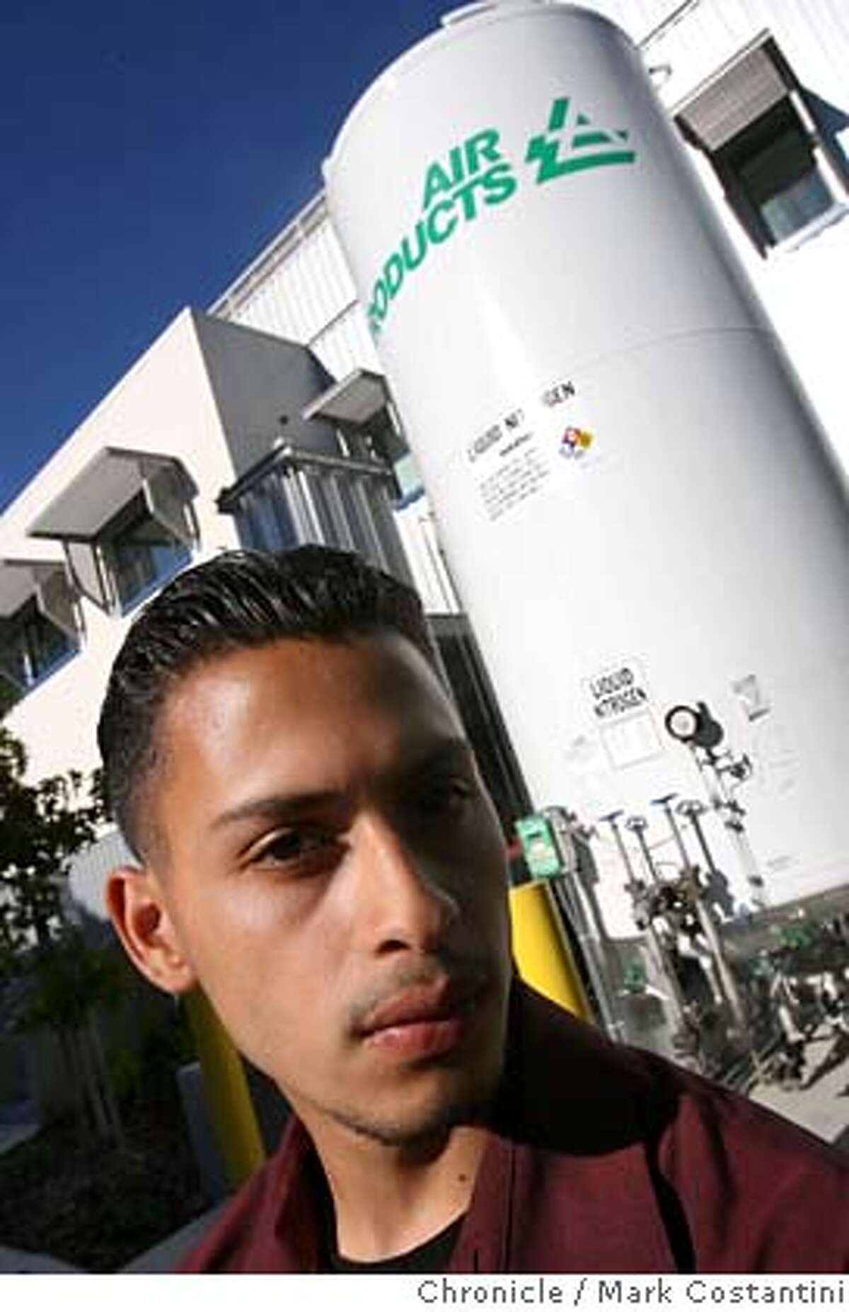 Jesus Hernandez at the building at Bayer that he did his research in. For a story about disadvantaged kids who have a shot at biotechnology jobs after participating in an internship/training program run by the non-profit organization , Biotech Partners. With poster presentations, the kids showcased the projects they worked on during summer internships, at an event Wednesday hosted by at Bayer Healthcare in Berkeley, Photo: Mark Costantini / S.F. Chronicle