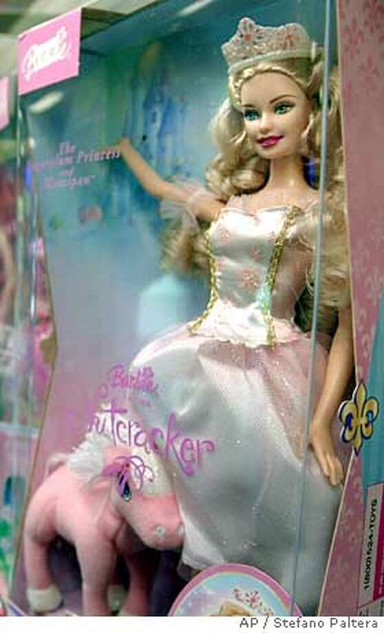 One of the newer Barbie doll from seats on a shelf inside Gregory's Toys in the Encino area of Los Angeles, today December 24, 2003. (AP Photo/Stefano Paltera) Photo: STEFANO PALTERA
