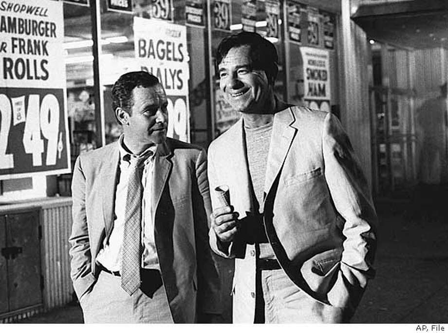"""FILE--Actors Jack Lemmon, left, and Walter Matthau stroll down Broadway in New York during filming of """"The Odd Couple"""" in 1967. Lemmon, the two-time Oscar winner whose acting talents ranged from the adroit comedy of ``The Apartment'' and ``Some Like It Hot'' to the dramatic intensity of ``Days of Wine and Roses'' and ``Tuesdays with Morrie,'' died Wednesday, June 27, 2001. He was 76. (AP Photo/File)  Ran on: 08-26-2007  Actors Jack Lemmon (left) and Walter Matthau were in the 1968 movie version of &quo;The Odd Couple.&quo; Talent agent Roy Gerber was the inspiration for Matthau's character, Oscar. Photo: Handout"""