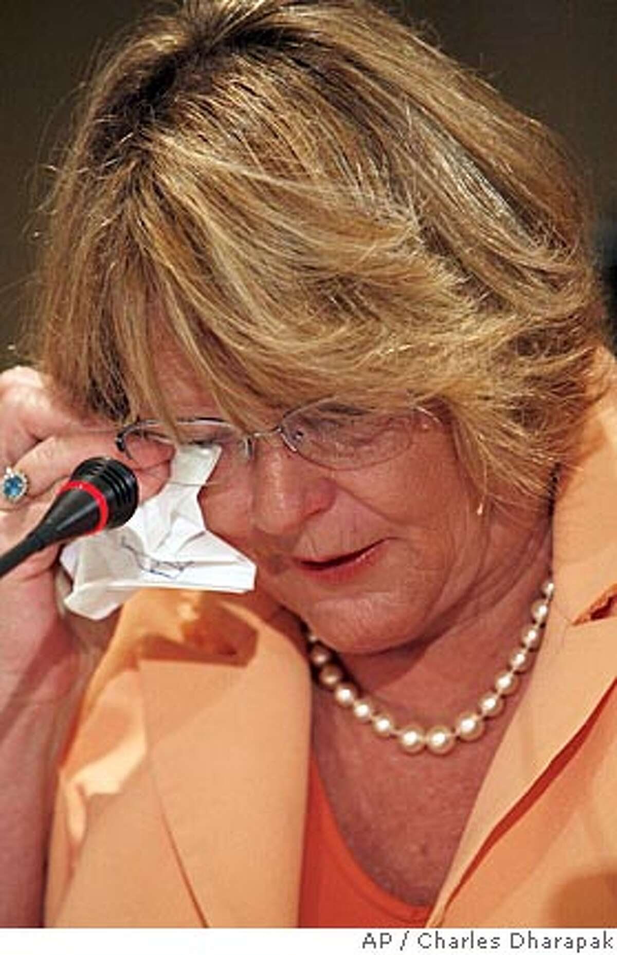 Karen L. Thurman, chair of the Florida Democratic Party, wipes a tear while testifying before the Democratic National Committee's Rules and Bylaws Committee in Washington, Saturday, Aug. 25, 2007. (AP Photo/Charles Dharapak)