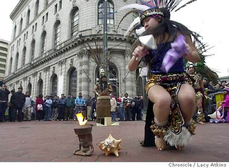 122803_HOLIDAYDANCE_LA.JPG  Liz Rivera one of the Aztec dancers from Mexico City dances the firedance to celebrate the blessed holiday season at Powell and Market, Sunday Dec. 28, 2003, in San Francisco.  CHRONILCE/LACY ATKINS Photo: LACY ATKINS