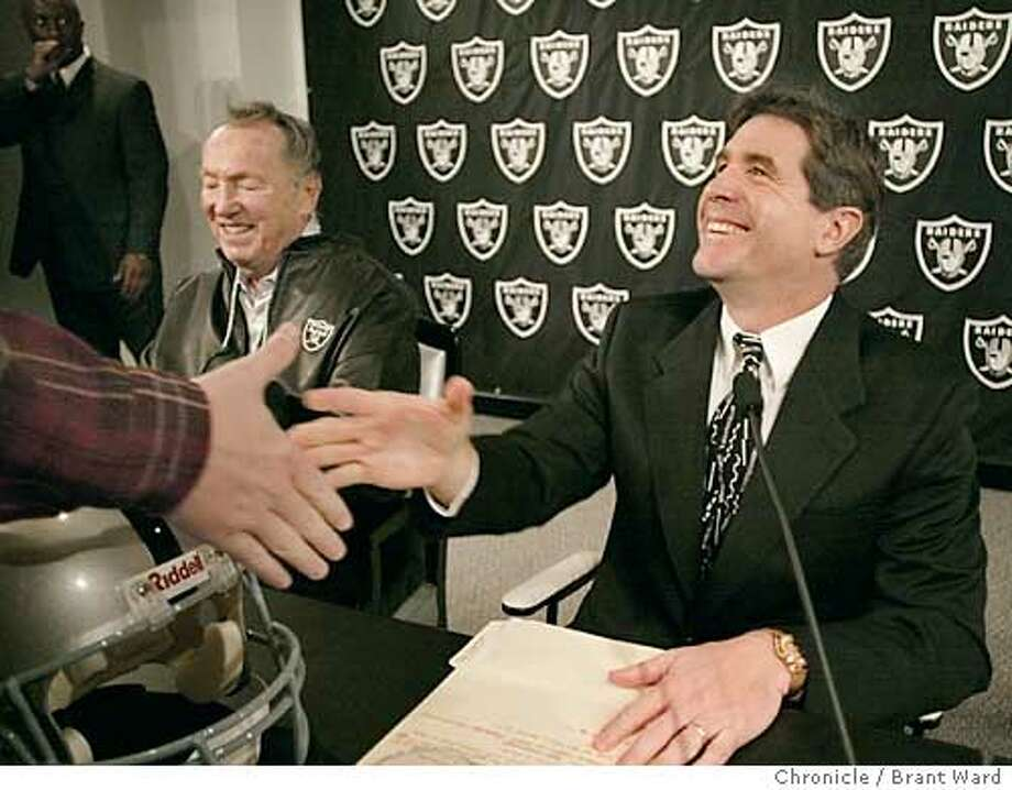 The Oakland Raiders introduced their new head coach Wednesday, former offensive coordinator Bill Callahan, right, received congratulations after a morning press conference at the Alameda headquarters. Raiders owner Al Davis smile at left. By Brant Ward/Chronicle Photo: BRANT WARD