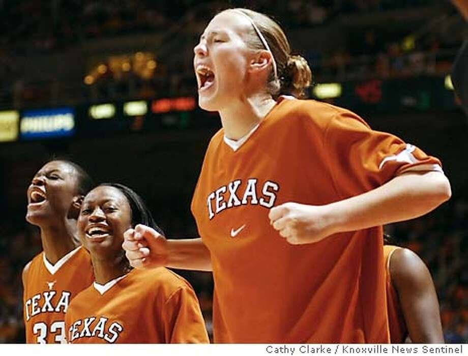 Texas' Jody Bell, right, Tamra Cobbins, center, and Tiffany Jackson yell to their team Sunday, Dec. 28, 2003 in Knoxville, Tenn. during the game against Tennessee as the Lady Longhorns won 70-60.(AP Photo/Cathy Clarke / Knoxville News Sentinel) Texas' Jody Bell (right), Tamra Cobbins (center) and Tiffany Jackson celebrate the Longhorns' upset of No. 2 Tennessee. Photo: CATHY CLARKE
