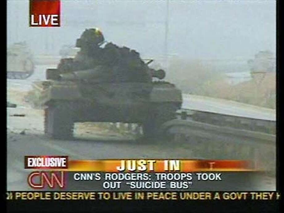 An Iraqi T-72 tank burns after an encounter with the 3-7th Cavalry Division a few miles from Saddam International Airport. CNN's Walter Rodgers, embedded with the 3-7th, reported at least 10 Iraqi tanks met U.S. troops. Photo credit: CNN An embedded CNN reporter was with a unit that fired on Iraqi tanks outside of Baghdad. Photo: CNN