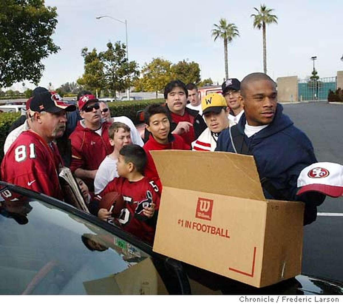 ; 49ers Jason Webster hands out gifts to fans as he departs the 49ers headquarters in Santa Clara after a below average season of 7 wins, 9 losses. City:� 12/28/03, in Santa Clara, CA. City:� . Frederic Larson/The Chronicle;