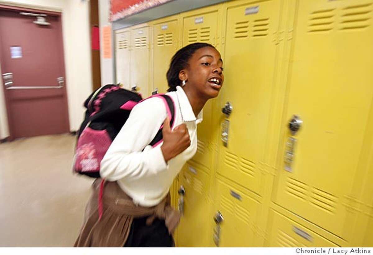 Tierra Turner yells through the halls at the Visitacion Valley Middle School, March 27, 2007, in San Francisco, Ca. (Lacy Atkins San Francisco Chronicle) *Tierra Turner Ran on: 08-26-2007 Tierra Turner pauses for a moment at the door of her home in the Bayview. The slaying of her older brother has taken an emotional toll on the 12-year-old.