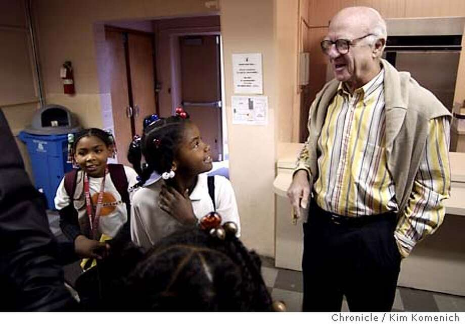 11/5/03 in San Francisco.  Gap Chairman Donald Fisher visits the Bayview Academy, a school following the KIPP method, which he has funded to the tune of $32 million. He jokes with kids on their way to class after an assembly.  KIM KOMENICH / The Chronicle Photo: KIM KOMENICH