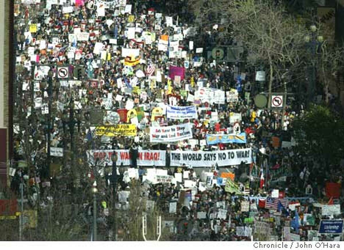 Protesters march against the war in Iraq in February on Market Street in San Francisco. Chronicle photo by John O'Hara