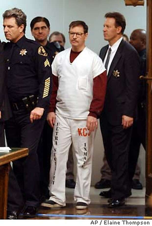 Gary ridgway is escorted by guards to his sentencing thursday dec 18