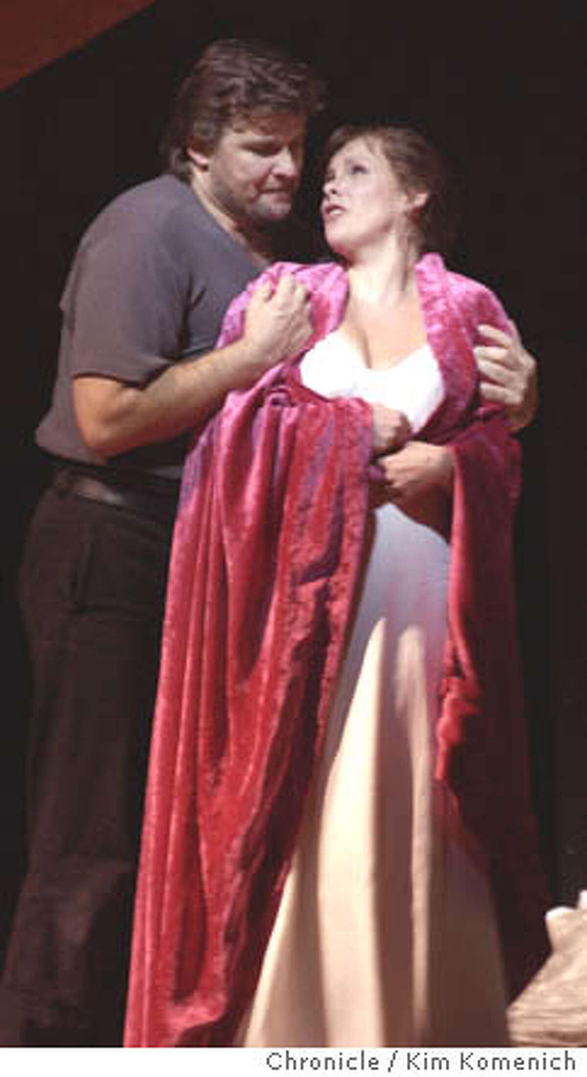 11/6/03 in San Francisco. San Francisco Opera presents Lady Macbeth of Mtsensk. Sergei (Christopher Ventris) gets friendly with Katerina (Solveig Kringelborn), KIM KOMENICH / The Chronicle