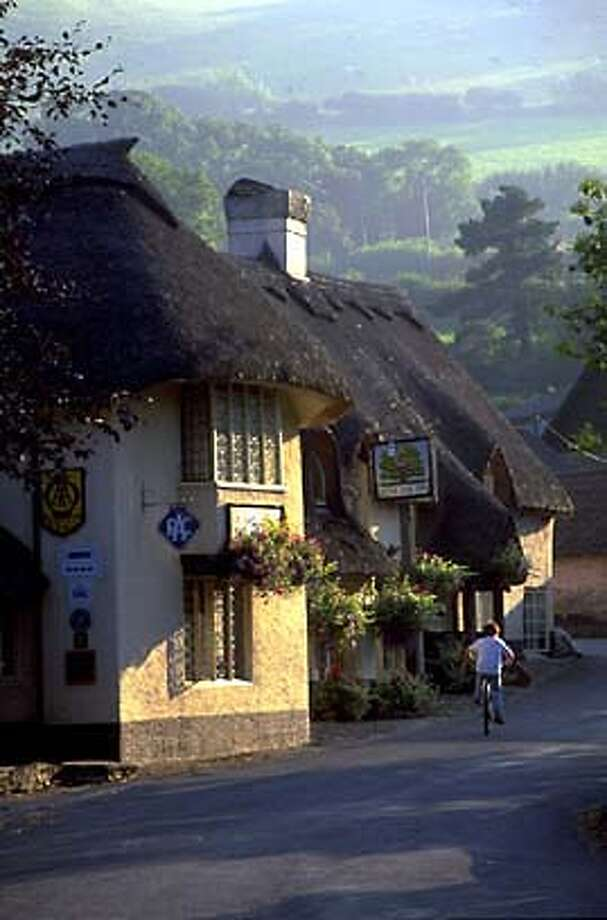 TRAVEL FOLLOW THE READER SOMERSET -- Thatched cottages are a common sight in Somerset, in southern Britain. Credit: British Tourism Authority.